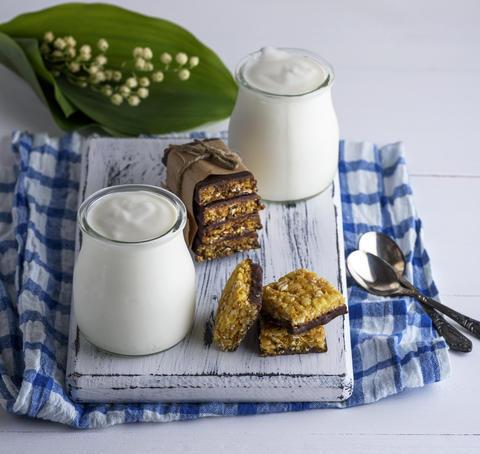 two jars with homemade yogurt and snacks from muesli Photo