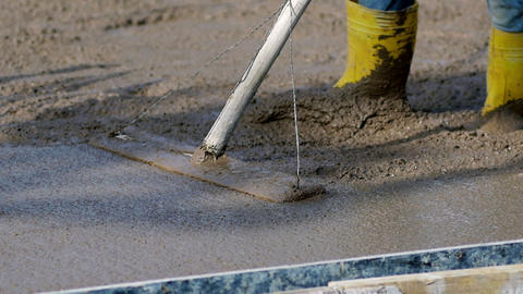 Slow Mo. Concreting and smoothing slab on the building. Pouring fresh concrete Live Action
