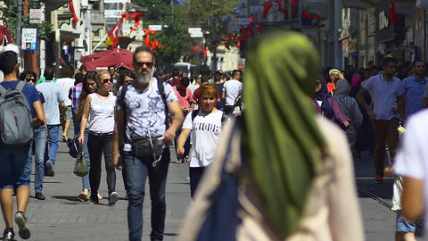 Pedestrians walk slow motion on Istiklal Caddesi, city's iconic Footage