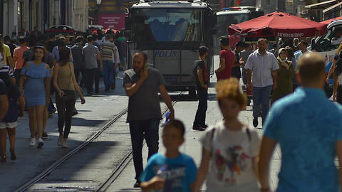 Armored police car patrols along in the crowded Istiklal Street. Heavily armed 영상물