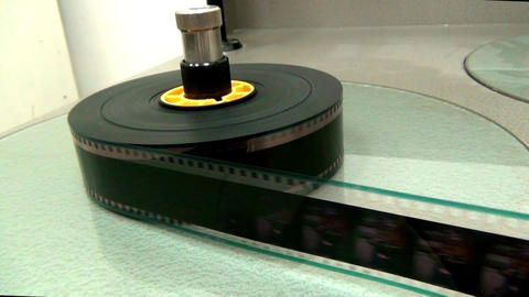 Rewinding reel of old film Footage