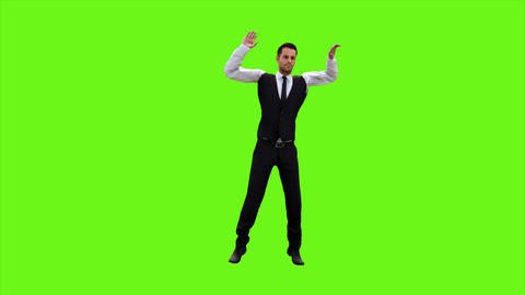 Young businessman dancing after a successful transaction on a green screen Animation