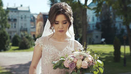 Portrait of a bride with a bouquet in her hands who smiles Stock Video Footage