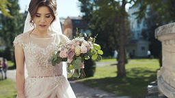 Portrait of a bride with a bouquet in her hands who smiles Footage