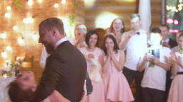 Young beautiful bride and groom dancing first dance at the wedding party Footage