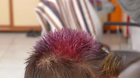 barber hair coloring, the boy coloring the hair for the… Stock Video Footage