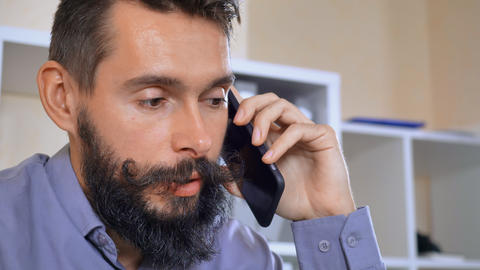 bearded guy calling by mobile Footage