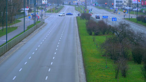 Early morning, empty road, sometimes passing cars Footage