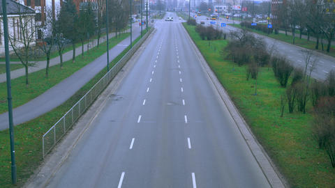The sleeping neighborhood is an empty road, sometimes cars are going Footage