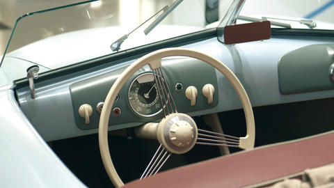 Dashboard of a retro sports car Live Action