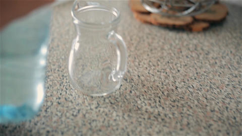 The child pours from a plastic bottle into a jug of clean drinking water 영상물