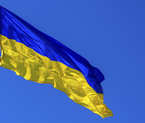 textile flag of Ukraine develops against a clear blue sky Fotografía