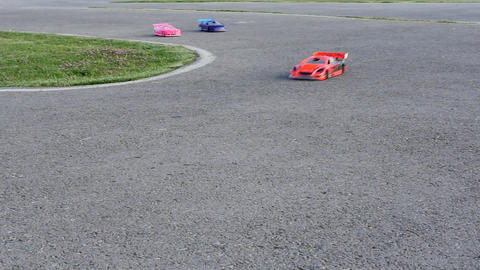 Racing RC Cars. Remote control cars on asphalt track. World of high-speed, Footage