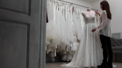 beautiful girl looking wedding dress in the cabin compared to other dresses Footage