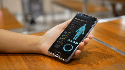 Hands of woman using mobile phone smartphone with Health analysis Live Action