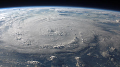Satellite view of a large hurricane with a well defined eye Live Action