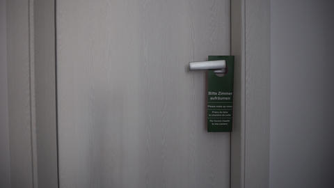 Please Make Up Room Sign On Hotel Room Door Handle, Close Up Live Action