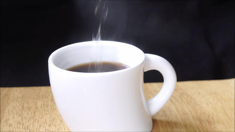 Pouring hot water in a coffee cup Footage