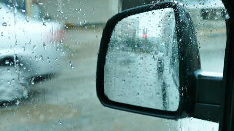view of the rain from the rear view mirror Live Action