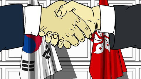 Businessmen or politicians shake hands against flags of Korea and Hong Kong Footage