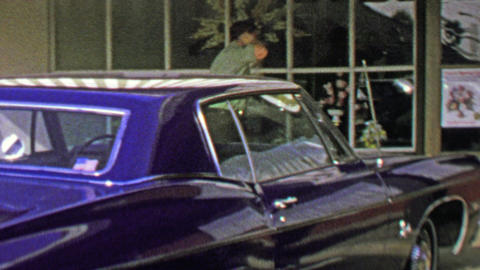 1974: Man open floral shop small business physical store Footage