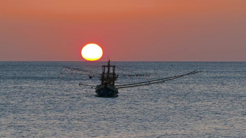 fishing boat in the sea against sunset, timelapse Footage