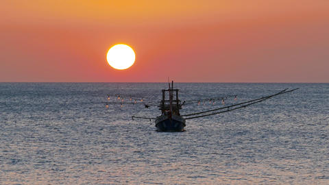 fishing boat in the sea against sunset 영상물