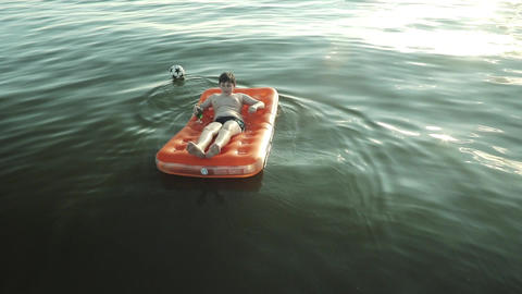 Boy Floating On Air Mattress In The Sea Footage