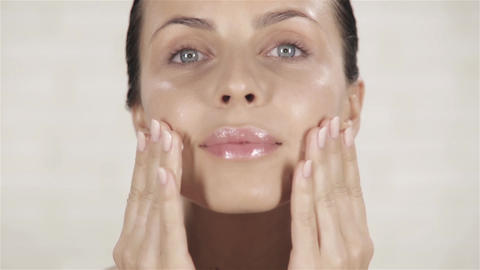 Young Woman Applying Face Cream Footage