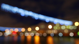 City traffic lights shimmer line, defocused view. River bank at night Footage