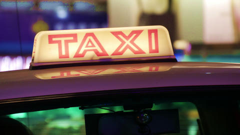 Illuminated Taxi Cab Sign On A City Street Footage