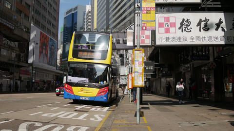 Cars and buses move along a busy road in Kowloon City District Footage