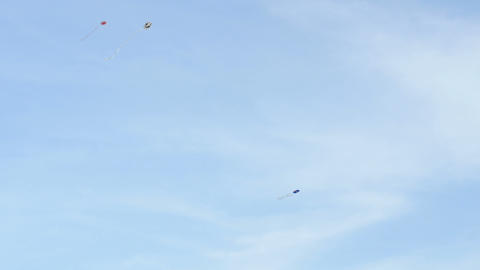 kite flying over blue sky background, day Footage