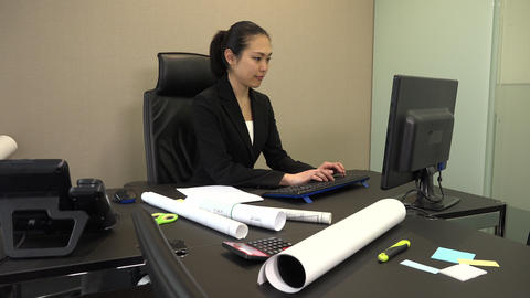 Young Woman At Work And Typing On Pc In Office Footage