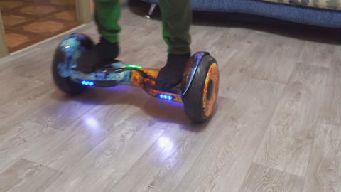 A teenager uses hoverboard in his home room Archivo
