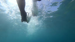 Paddling with fins, view from under water Footage
