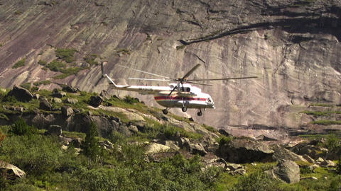 Rescue helicopter fly ower a high rocky mountain 영상물