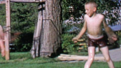 1967: Boy splashes kids pool girlfriends showboat fun Footage