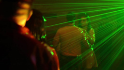 Young people dancing at a party spotlight and lasers 07a Footage