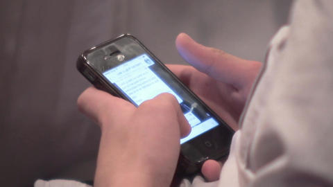 Child reads on his mobile phone screen 79 Footage