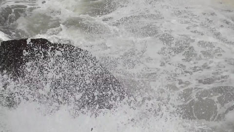 Waves that burst the rocky shore forming foams and bubbles 20 Footage