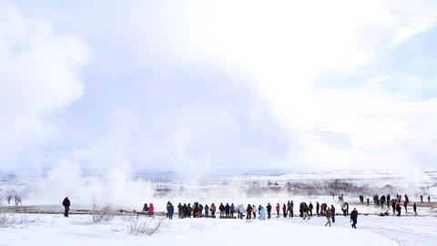 Visitors at the geyser eruption of Strokkur, Iceland Live Action
