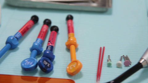 a close up of the dental instruments (with hands in work) Live Action