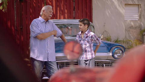 1-Grandfather Telling History Of Vintage Car To Grandson stock footage