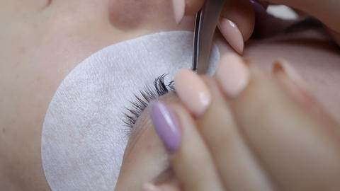 Beautician makes eyelash extension Footage