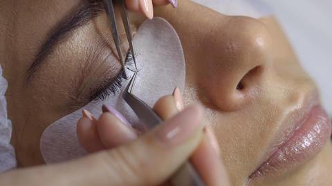 Process of making eyelash extension in beauty salon Footage