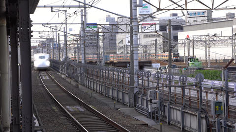 Shinkansen or a Japanese bullet train arriving at Nagoya station Live Action