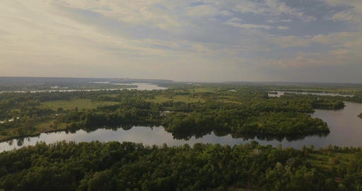 Aerial View. Flying over the beautiful lake. Sunny Day. Aerial camera shot Footage