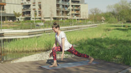 Fitness young woman practicing yoga in the morning Footage