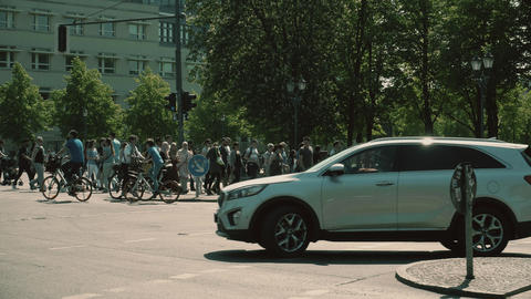 BERLIN, GERMANY - APRIL 30, 2018. Pedestrians and cyclists crossing the street Footage